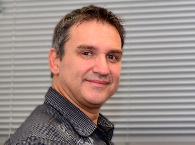 Dr-John-Kirmos