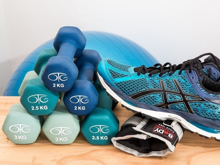 Weights and running shoes and fitness ball